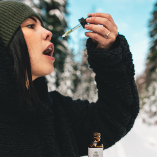 How Often Can You Take CBD Oil - woman about to take CBD sublingually